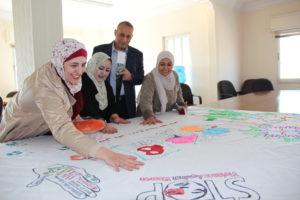 Kiaf Abu Khiarah laver banner til 8. marts. Credit GFJTU